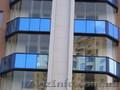 Безрамные раздвижные окна и двери  для балконов и веранд