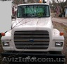 Продаем седельный тягач FORD L9000, 1996 г.в. с полуприцепом-платформой Lowboy, Объявление #1618638